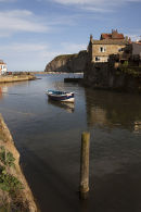 05D-5879 The Fishing Village of Staithes and its Harbour at High Tide Viewed from the Bridge Over Staithes Beck North Yorkshire UK