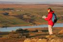 06-2010 Hill Walker with map enjoying the view over Baldersdale from Goldsborough Crag, Teesdale County Durham.