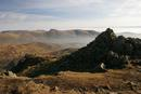 06-2271 The summit cairn of Red Screes with the Kentmere Fells behind. Lake District, Cumbria