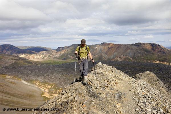 06D-1540 Walker Ascending the Mountain of Blahnukur via the North Ridge with the Laugahraun Lava Field Below Landmannalaugar Iceland.