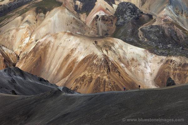 06D-1640 Hikers Decending the West Ridge of Blahnukur with the Colourful Slopes Brennisteinsalda Volcano Behind Landmannalaugar Iceland.