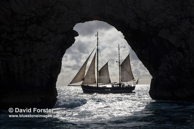 Ship Framed by Durdle Door, Dorset, UK