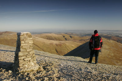 205-0643 Hill Walker on the Summit of Helvellyn, Lake District, Cumbria.
