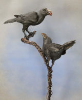 2 ceramic crows mounted on a steel frame
