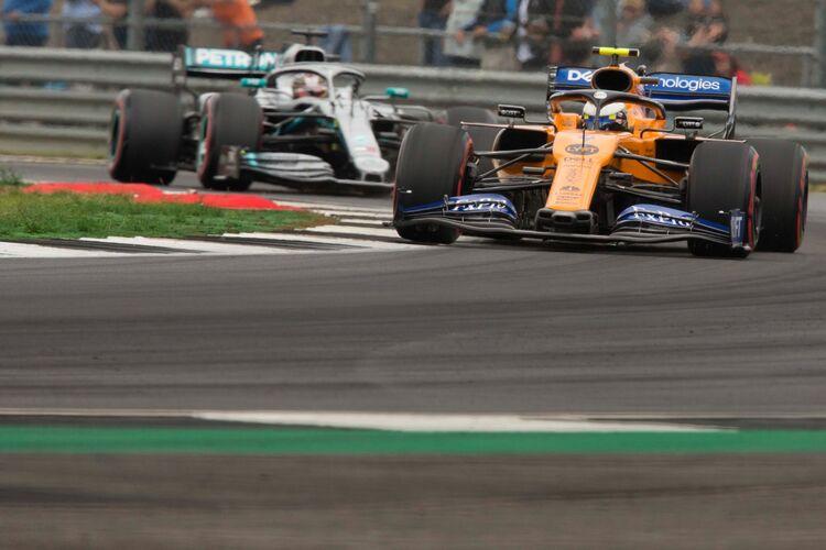 Lando Norris at Copse corner followed by Lewis Hamilton @Silverstone 2019