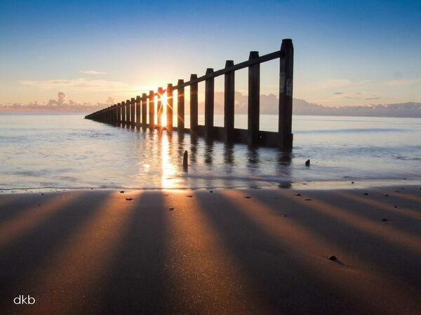 Sunrise rays of light Dawlish Warren