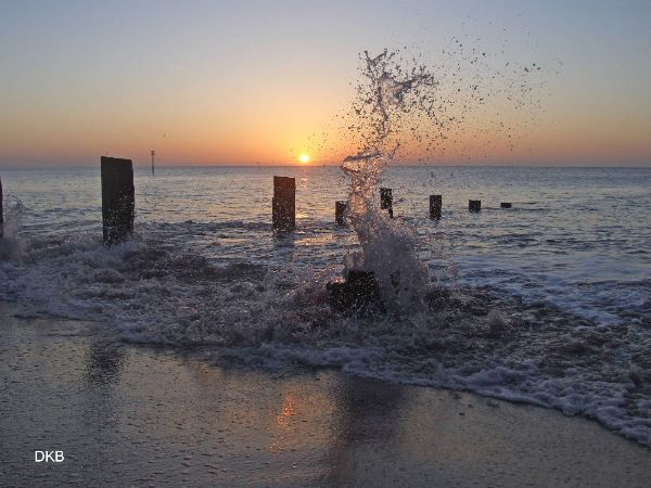 Sunrise splash Teignmouth Sands