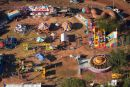 Fun fair rides at Freds Pass Rural Show, Darwin, Northern Territory, Australia - aerial