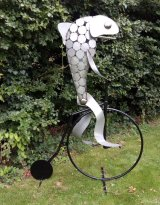 Fish on a Penny Farthing