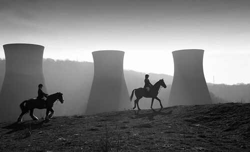 Horse riders and Power Station Cooling Towers, Britain 2019