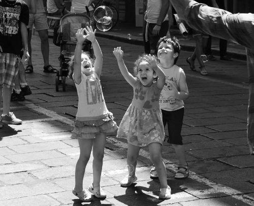 Children catching bubbles