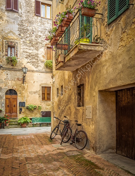 BICYCLES IN PIENZA by Mike Arblaster