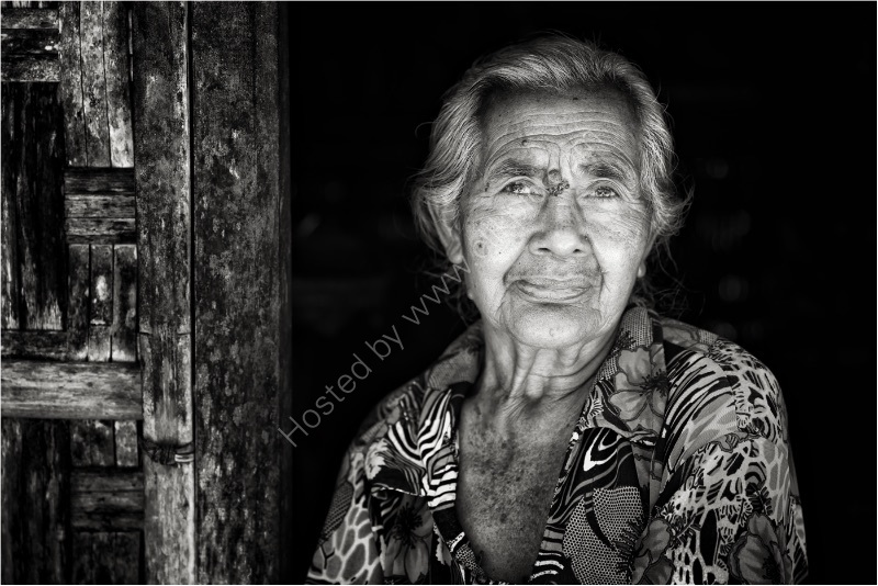 SLOW DAY - BALINESE STREETSELLER by Jim Connolly