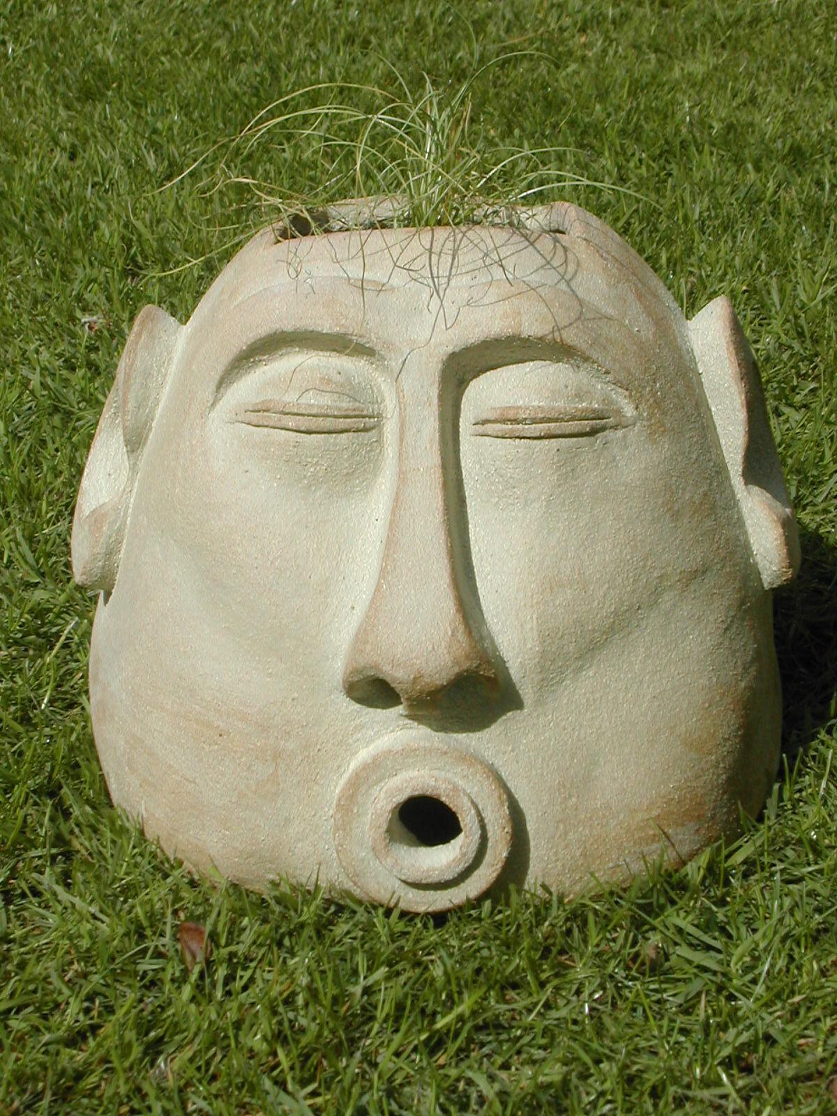 Grass pot man singing