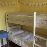 Westward Ho! Our bunk bed room with toy box and desk for colouring