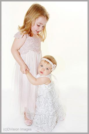 Holding little sister up