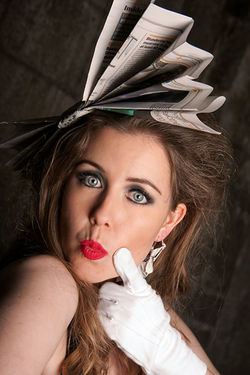 Kate Long white gloves and a Hat made of Newspaper