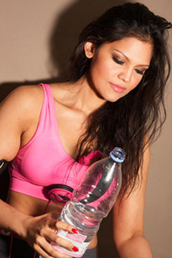 Jasmine Rehydrating between WorkOut Sessions