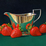 A Silver Jug With Strawberries