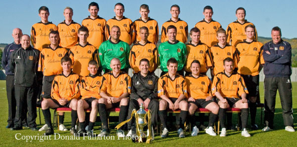 The Dumbarton Football Club manager and team with the Scottish third division trophy.