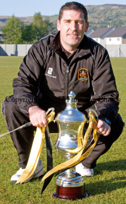 Dumbarton Football Club manager Jim Chapman with the Scottish third division trophy.