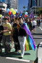 Participants of the 2010 Brisbane Pride March walk the streets of Brisbane to celebrate their pride.
