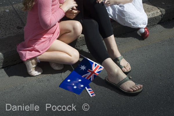 Onlookers on the side of the road at the Anzac Day March in Brisbane.