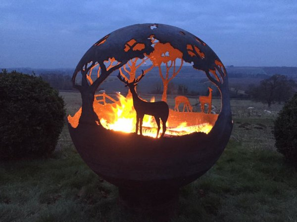 'The Deer Fire Pit' by night