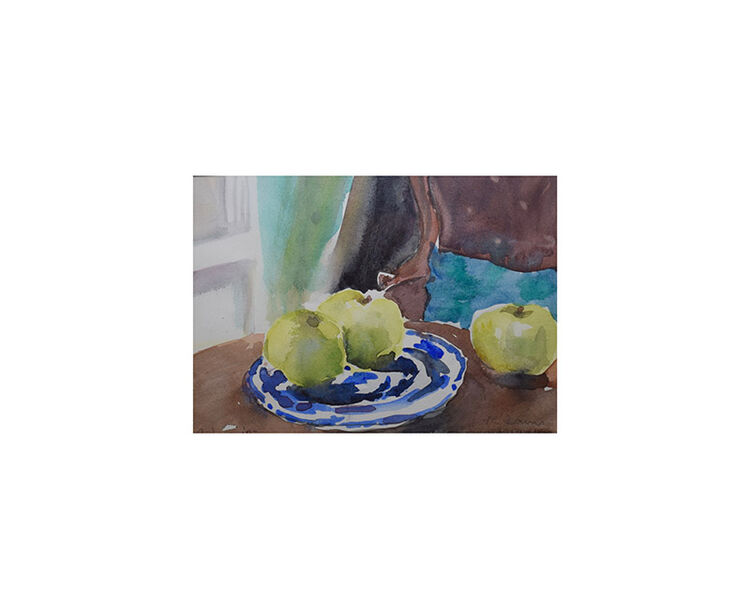 Apples on blue plate