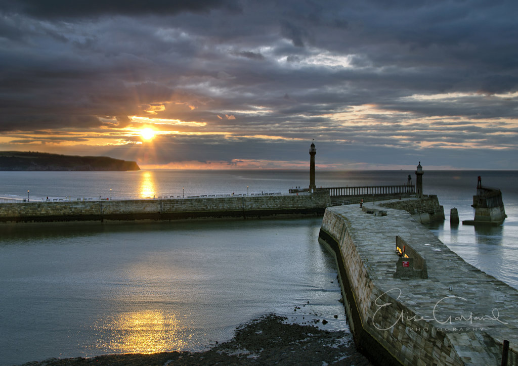 Whitby harbour at sunset