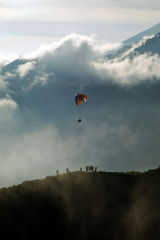 Paraglider in volcanic mist, Mount Batur crater, Bali