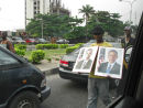 street sellers during rush hour, Barack Obama posters