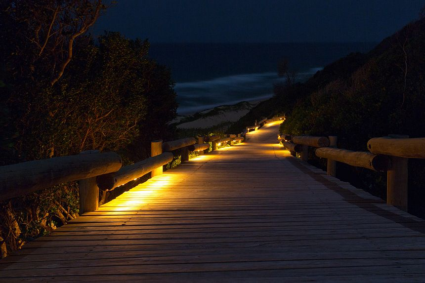 A path leads down to the beach for an evening walk along the surf.