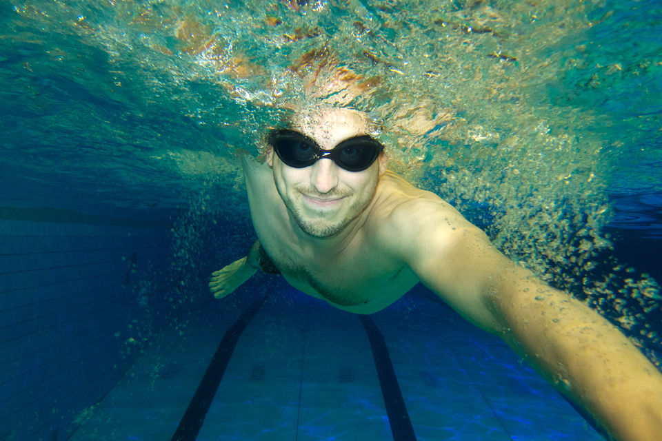 A swimmer in a public swimming pool filled with Dunea water. Canon PowerShot S100, 1/60, f/2, iso 400, handheld, Ikelite underwaterhouse.