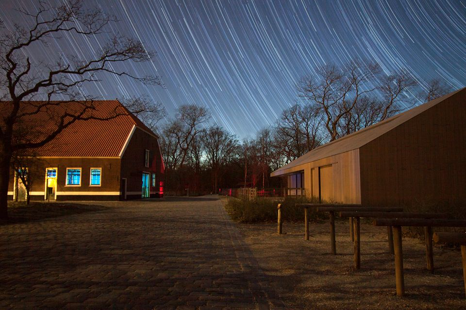 Startrails and De Tapuit, Dunea's visitor centre. Canon 50D, Canon EF 100mm f/2.8 USM Macro, stacked image, iso 100, handheld.