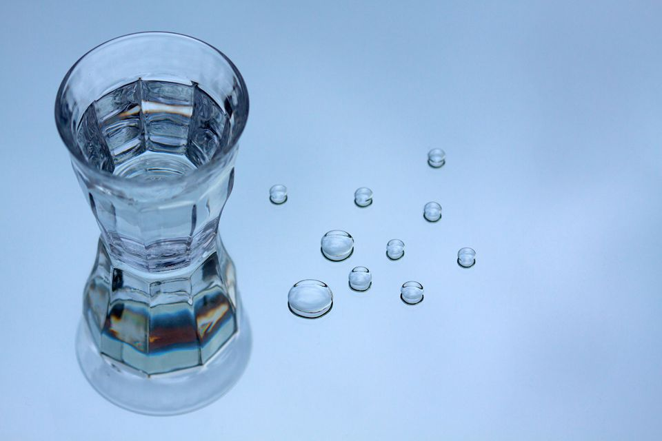 A glass of water & droplets. Canon 50D, Canon EF 100mm f/2.8 USM Macro, 1/250, f/4, iso 100, tripod.