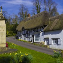 Thatched Cottage and War Memorial Wherwell,Hampshire ,England.