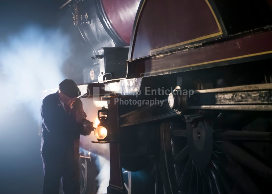 Railway worker lubrication a Midland Railway 1000 Class Locomotive at Barrow Hill Roundhouse ,