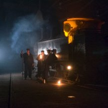 Group of railway workers around steam locomotive at Barrow Hill Roundhouse