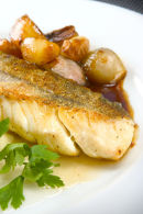 Roast haddock with caramelised shallot and garlic with champ.