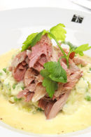 Boiled Ham Hock with grain mustard sauce and spring vegetable mash.