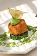 Fishcakes with green vegetables and butter sauce.