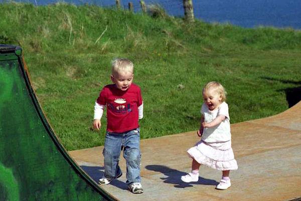 Logan and Aila on the skateboard ramp