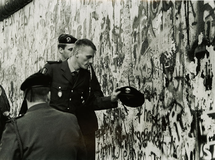 Foreign Soldiers Examine Hole