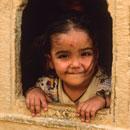 little jaisalmer girl in a window