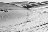 Pylons in snow, Winding Bottom, South Downs nr Steyning, West Sussex