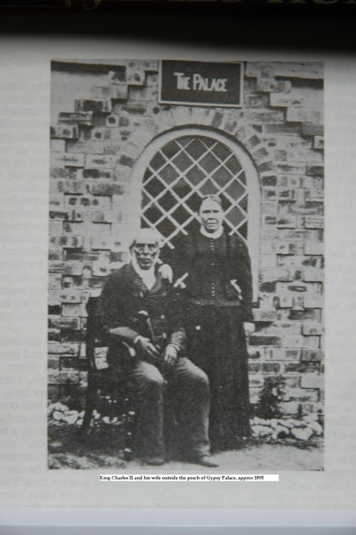 King Charles and his wife pose outside the palace, taken around 1898