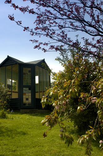 The summerhouse actually started life as a small railway station waiting room.