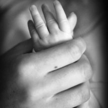 Baby hand in hand.