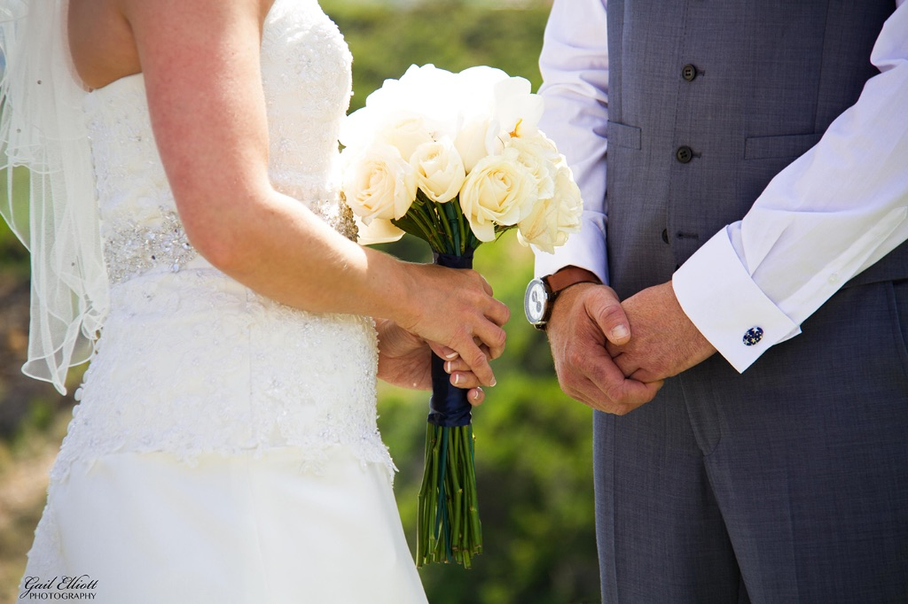 Bouquet clasped hands